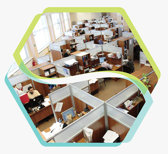 aerial photo of an office with multiple cubicles for employees. It has a Fibre To The Premises broadband connection.