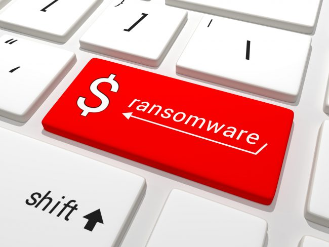 Partial image of a keyboard with the Enter key highlighted in red and labeled 'ransomware' and a dollar sign.